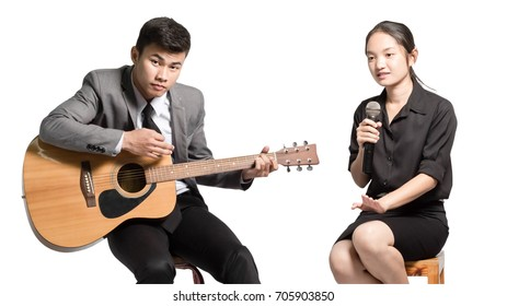 Portrait of a young business man with guitar and business woman with microphone. Office party concept. Isolated on white background with clipping path