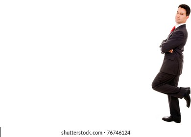 Portrait of a young business man leaning up against the wall. Isolated on white background and much space for own text