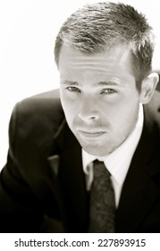 Portrait of a young business man looking serious or worried.