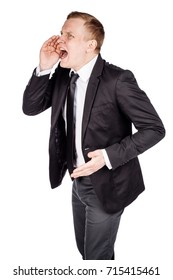 Portrait of a young business man shouting loud with hands on the mouth. human emotion expression and lifestyle concept