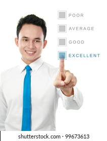 Portrait of a young business man smiling with computer in the office