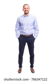 Portrait of young business man standing with hands in pockets on a white background