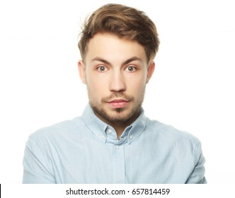 portrait of a young business man surprised face expression