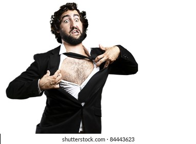 portrait of young business man tearing his suit over white
