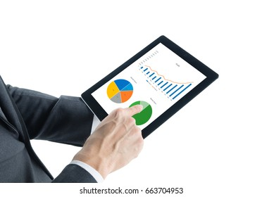 Portrait of young business man wear grey suit hold digital tablet in hand and checking analyze data of growing financial chart of sale, revenue and profit in tablet isolated on white background