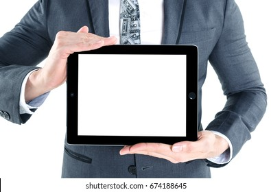 Portrait of young business man wear grey suit holding digital tablet in hand with white screen for your design isolated on white background