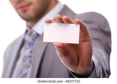 portrait of a young business man with white card
