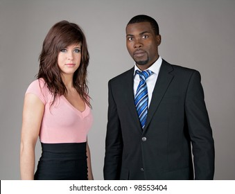 Portrait of young business partners, Caucasian woman and African American man.