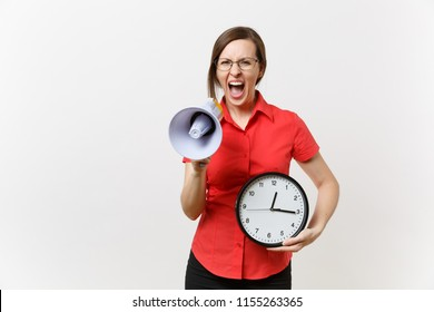 Portrait of young business teacher woman in red shirt holding round clock, scream in megaphone, announces discounts sale, isolated on white background. Hot news, communication concept.. Hurry up