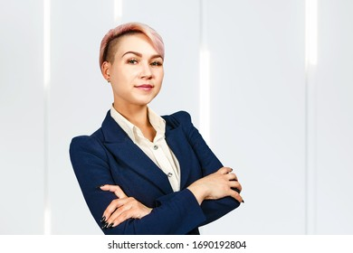 Portrait of young business woman with crossed hands.