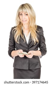 Portrait of young business woman holding a dollar banknote in her hand. image on a white studio background. business and lifestyle concept