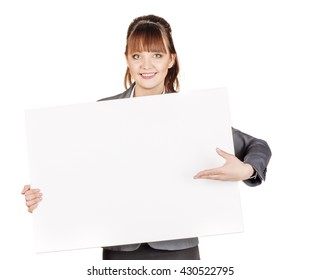 Portrait of young business woman holding a blank banner. image on a white studio background. business and lifestyle concept