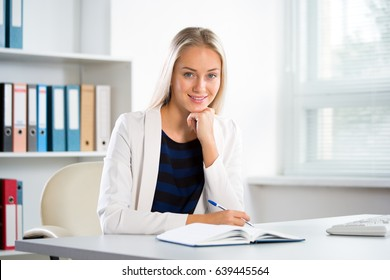 Portrait of a young business woman in an office