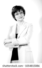 Portrait of a young business woman on a white background. Monochrome photography.