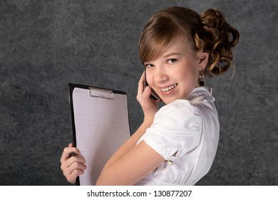 portrait of a young business woman on a gray background