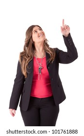 Portrait of young business woman pointing up