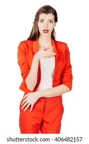 portrait of young business woman in red suit scared ,afraid and anxious looking to the camera, with wide opened eyes. isolated on white background. business and lifestyle concept