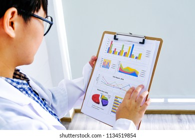 Portrait of young business woman with see graph