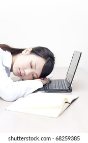 a portrait of young business woman sleeping on the desk
