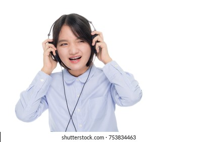 Portrait of a young business woman smiling with earbuds / headphone for listening to music or talking on smart phone. Isolated on white background