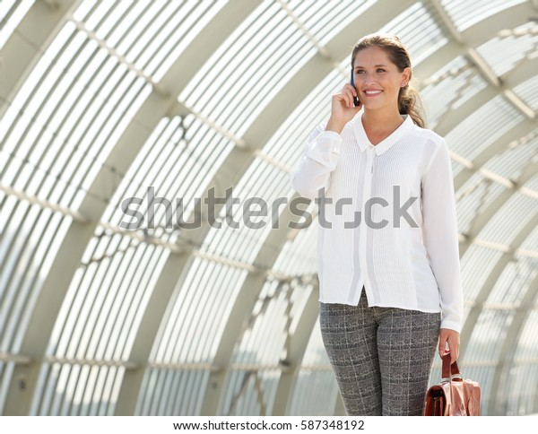 Portrait of young business woman talking on mobile phone
