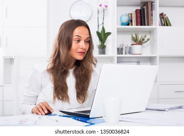 portrait of young business woman working on computer at firm office