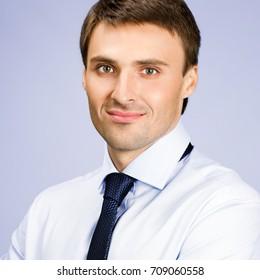 Portrait of young businessman, against violet background