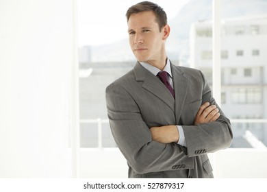 Portrait of a young businessman with arms crossed