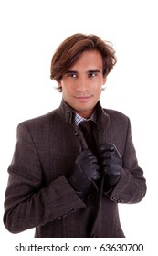 Portrait of a young businessman, in autumn/winter clothes, isolated on white. Studio shot