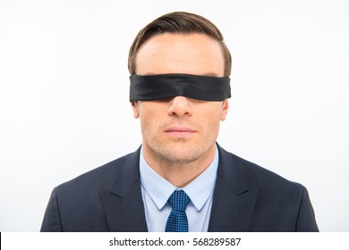 Portrait of young businessman in blindfold isolated on white