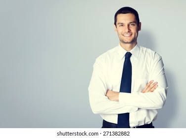 Portrait of young businessman with crossed arms pose, with blank copyspace area for text or slogan, specially toned