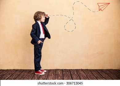 Portrait of young businessman with drawn airplane. Success, creative and start up concept. Copy space for your text