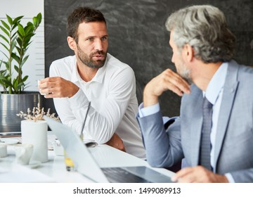 portrait of a young businessman drinking coffe in a restaurant coffee bar