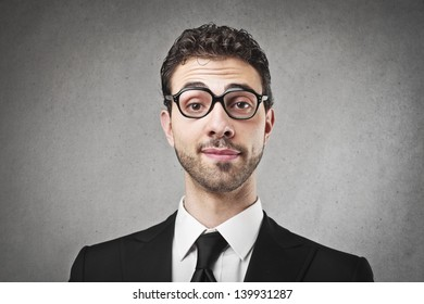portrait of young businessman with glasses