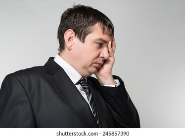 portrait of a young businessman hand covers the face