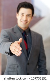 portrait of a young businessman with hand outstretched