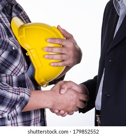 Portrait of young businessman handshake with the architect.