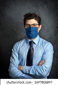 Portrait of young businessman in interior with virus protection mask on face