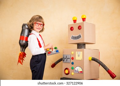 Portrait of young businessman with jet pack and robot. Success, creative and innovation technology concept. Copy space for your text