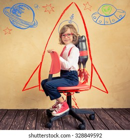 Portrait of young businessman with jetpack riding office chair. Success, creative and innovation technology concept. Copy space for your text