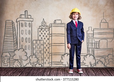 Portrait of young businessman kid in office. Success, creative and innovation concept
