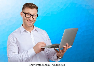 Portrait of young businessman with laptop