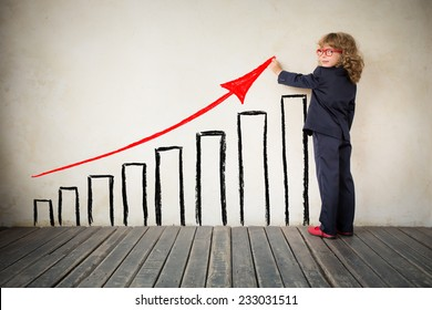 Portrait of young businessman in modern loft office. Drawn bar chart. Success in business concept. Copy space for your text