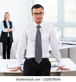 Portrait of a young businessman in an office