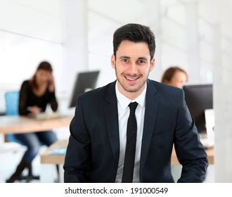 Portrait of young businessman in office