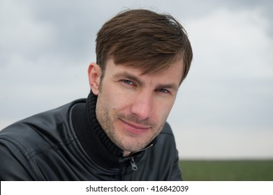 portrait of a young businessman businessman outdoors, age 35 years