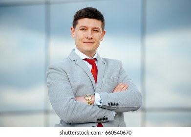 Portrait of young businessman outside. Happy business man.