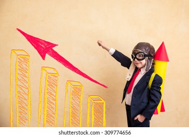 Portrait of young businessman with paper rocket. Success, creative and start up concept. Copy space for your text