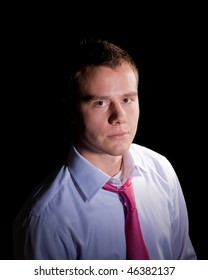 Portrait of young businessman in shirt and tie