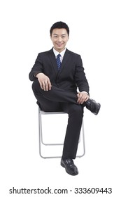 Portrait of young businessman sitting in chair,relaxing